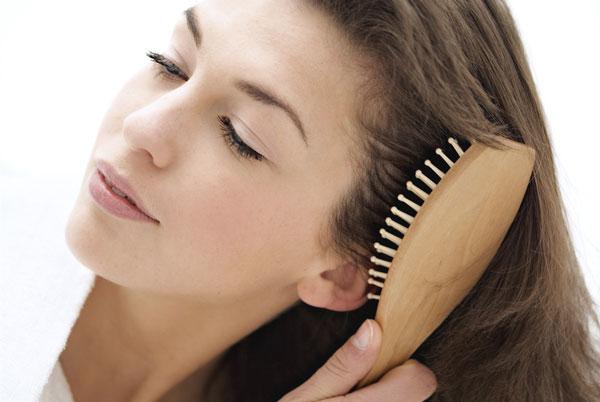 Girl Combing her hair pics